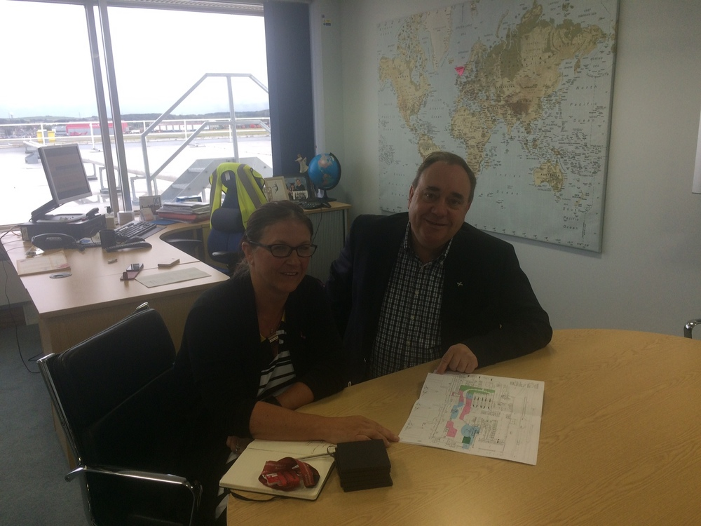 Carol Benzie (Director, Aberdeen Airport) and me looking over future plans.