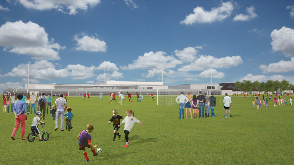 View across grass pitch. Photo: Lippe Architects + Planners Ltd