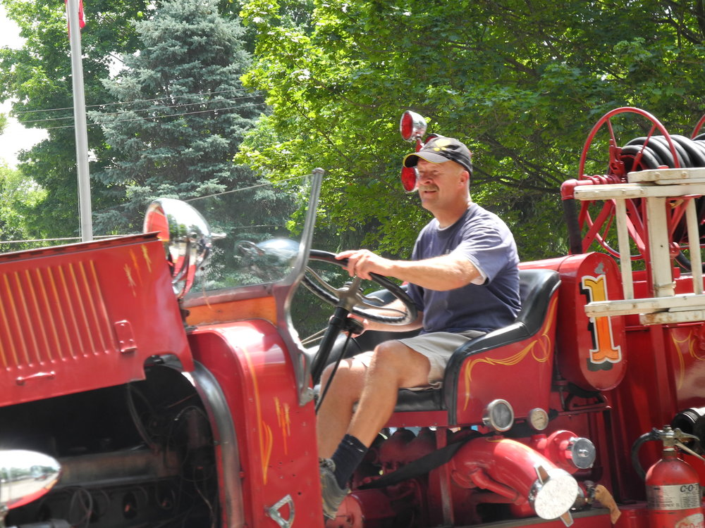 Chris driving the antique fire truck in Hadley's annual Fourth of July parade.
