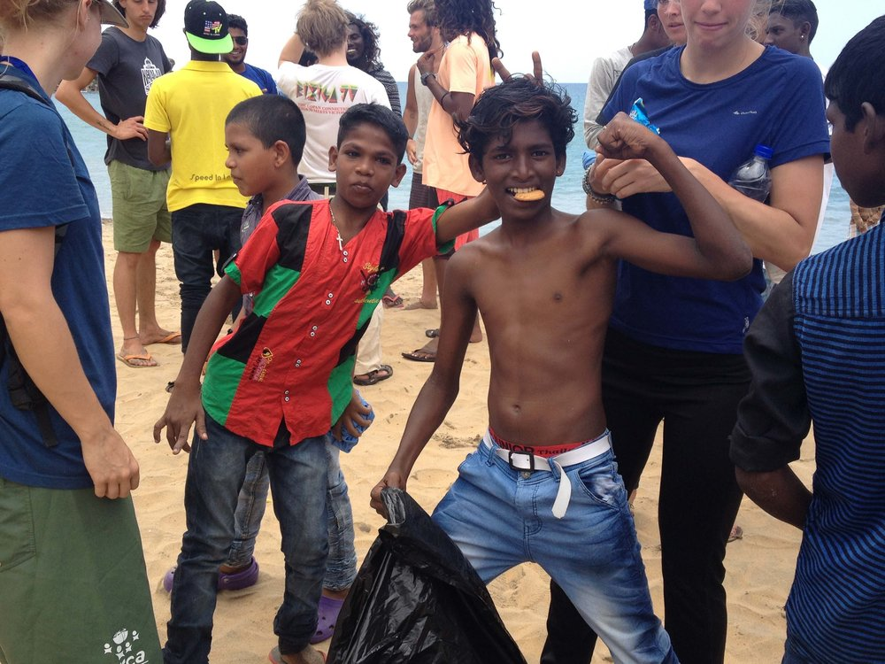 Some of the SISP kids from Vizhinjam assisting us with a local beach clean-up.