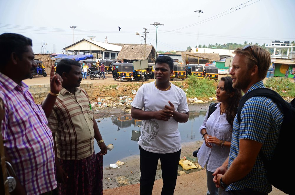 The team (from right) Cassidy, Elizabeth and our translator James (middle) discuss some of the issues facing the fishing industry in the region.