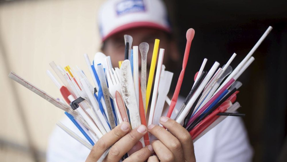 plastic straws on beach