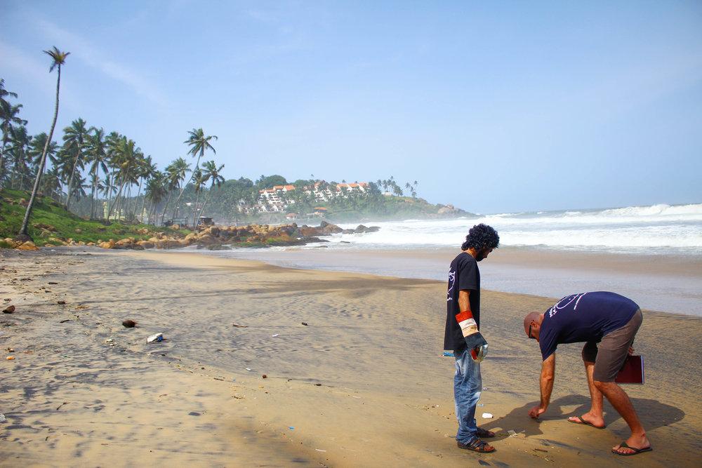 Krishna and Blake, our Global Program Co-ordinators, conducting a beach survey in Kovalam, Kerala, India.