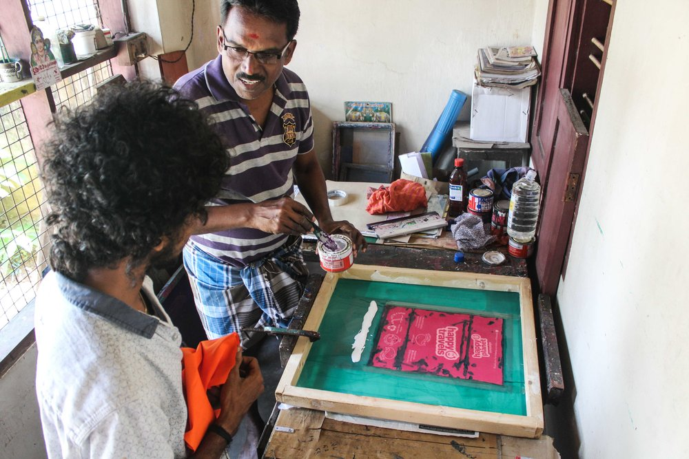 Our master printer and our Global Program Coordinator, Krishna, screen printing our bags before they are sewn and sent.