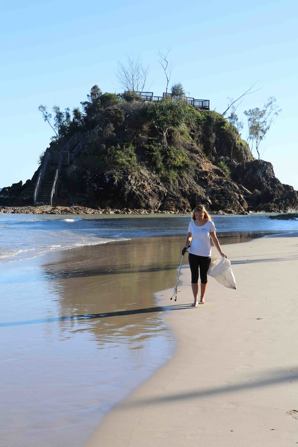 Zoe collecting cigarette butts for our joint local litter checks near The Pass in Byron Bay.
