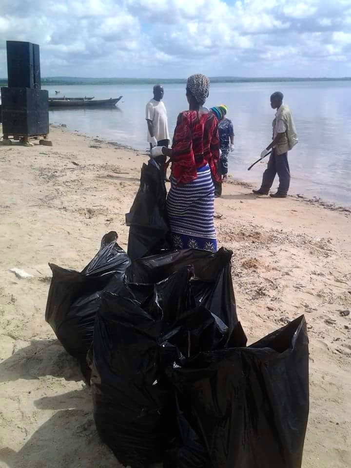 Members of the community of Tanga helping during one of LSBC's beach cleanups.