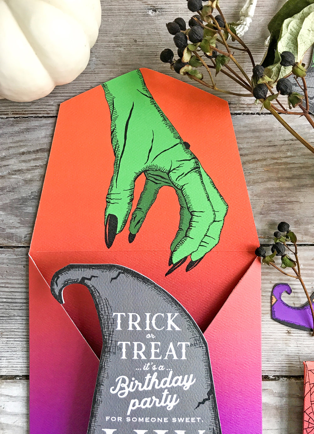 quite a spooky witches hand coming for that hat!