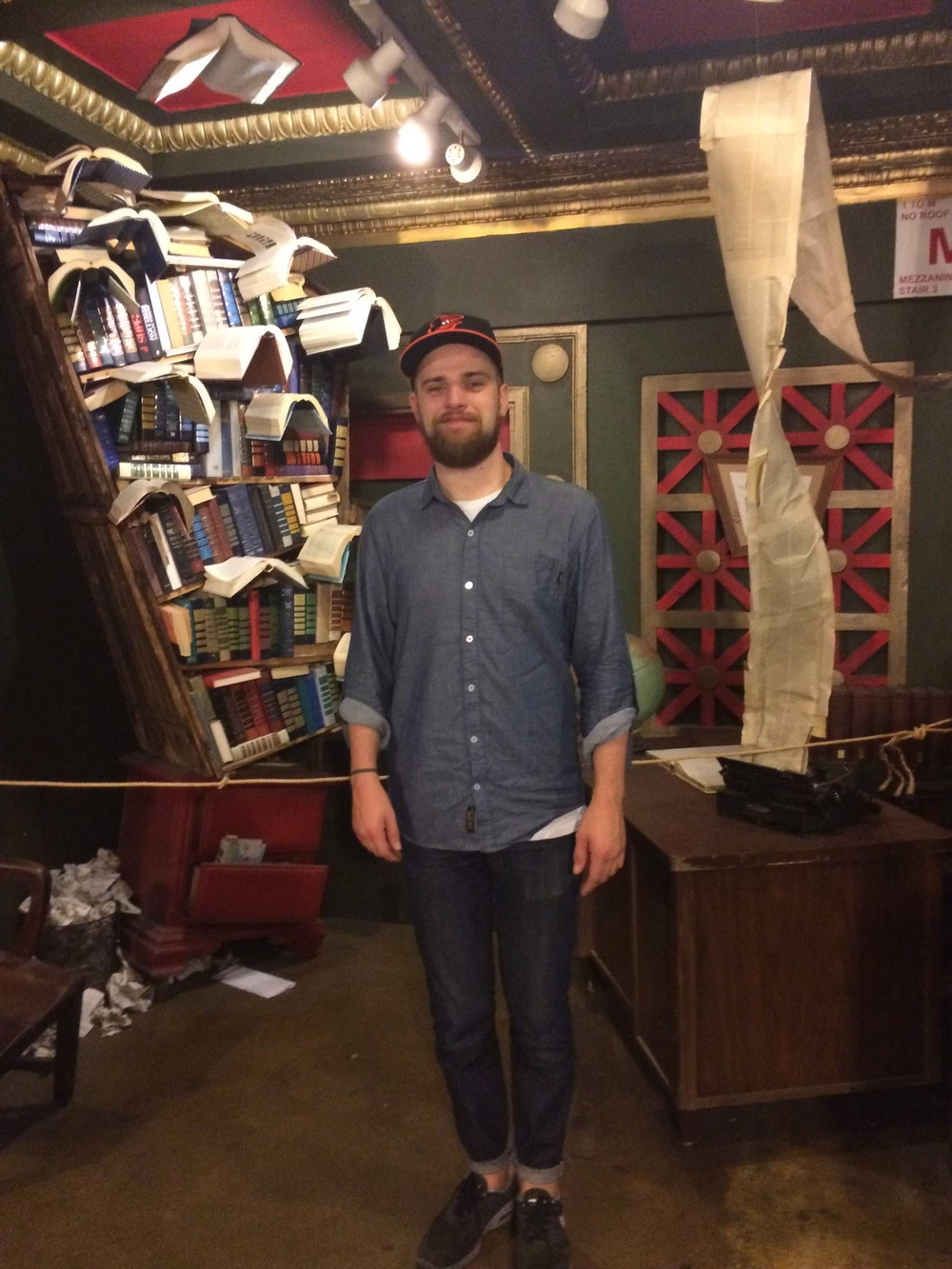 """Brian with some of the book art in the upstairs """"book labyrinth"""" at the Last Bookstore"""