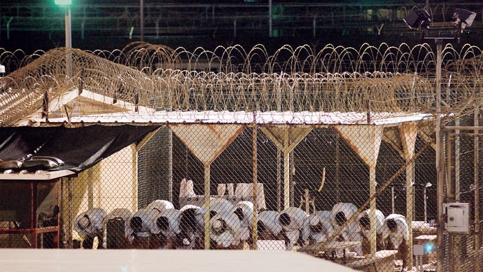 """Guantanamo prisoners at prayer in 2009. Gitmo was designed to be """"the legal equivalent of outer space,"""" according to the Bush administration. Photo:Louie Palu/ZUMApress.com"""