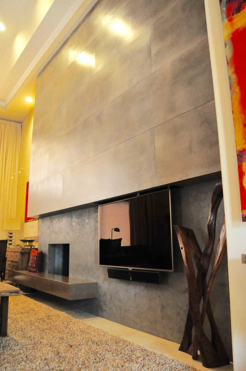 custom concrete, concrete wall, hidden tv, custom, stained concrete