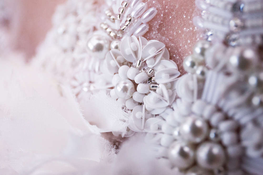 Hand beading detail by Claire Reed. Photographed by Claire Reed.