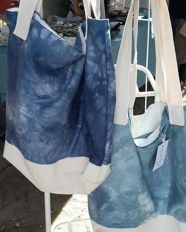 Galaxy totes hanging pretty at the @sundaybrunchfarmersmarket  #totebag #bag #handmade #handdyed #organic #oneofakind #market #buylocal #galaxy