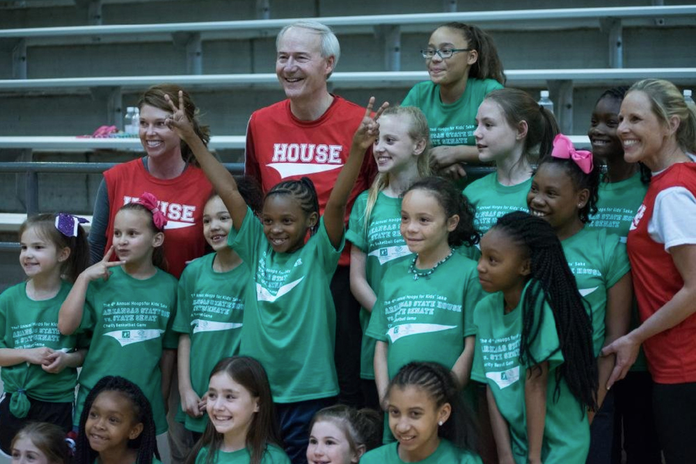 Governor Asa Hutchinson with children in attendance.