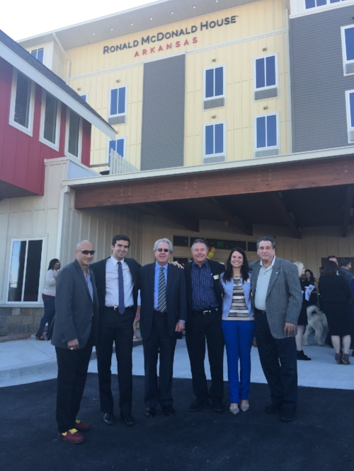 Ted Mullenix (third from left) and Austin Grinder (second from left) of Mullenix & Associates LLC celebrated the grand opening of the new Ronald McDonald House in Little Rock, Arkansas.