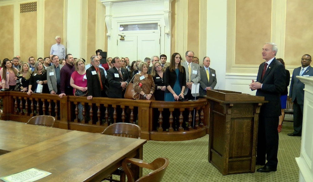 Governor Hutchinson speaking to members of the Arkansas REALTORS® Association in the Old Supreme Court.