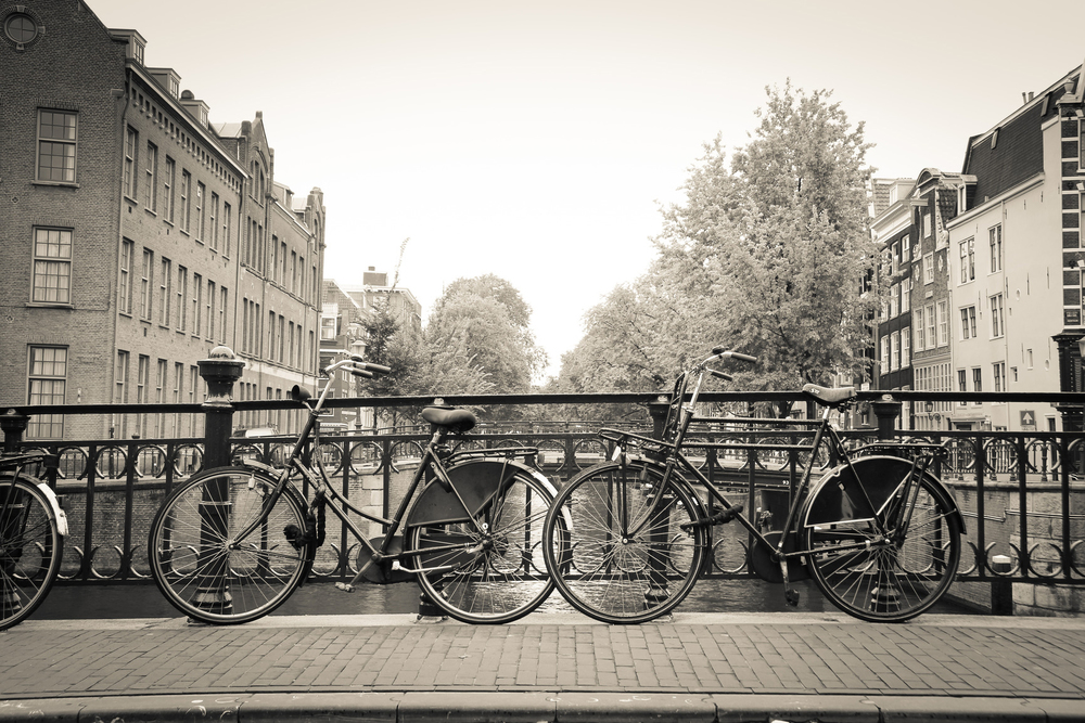 Couples of bikes over the canal of Amsterdam