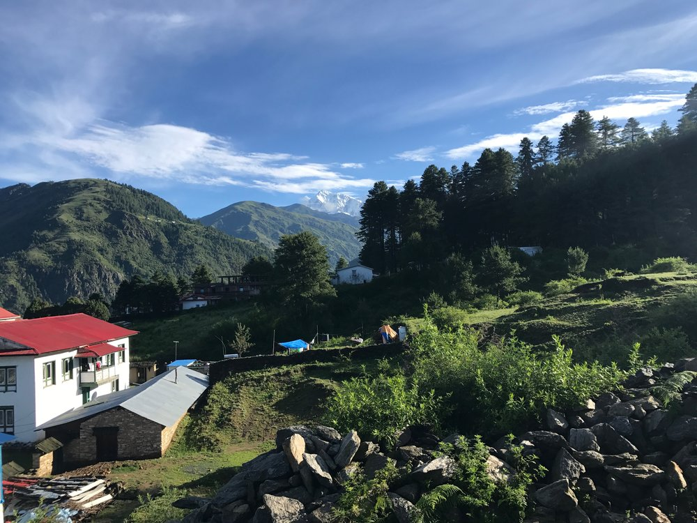 Above Photo Caption: The courtyard of the Kyirmu Lodge, Phaplu, Nepal with Mt Numbur in the background.  This is a possible future site of a Kcymaerxthaere installation by Eames Demetrios.