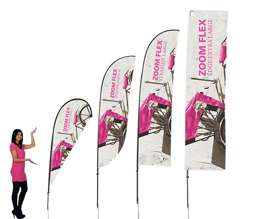 Flex Flags feature a full fiber pole and wind-resistant flag offered in several shapes. For indoor or outdoor use, the flexible design allows the graphic to rotate in the wind. Flex Flags come in your choice of single or double-sided and is offered in four shapes - Feather, Straight, Teardrop and Edge.