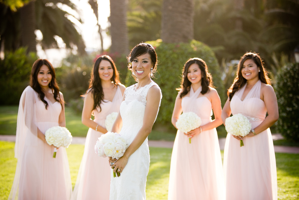 bride with bridesmaids in blush pink