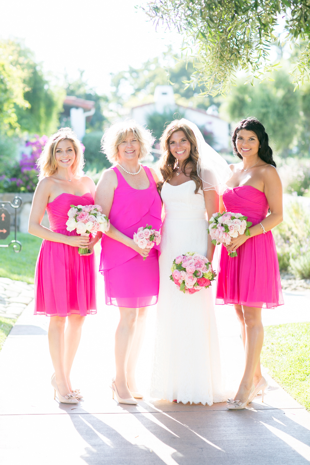 This bride just loved - pink.  All shades and hues.  Mom and bridesmaids looked radiant in the vibrant pink.   Their bouquets had the softer shades while the bride popped in the brighter hues into hers.  Don't be afraid of bright colors at a wedding.  Done in the right way they can be beautiful.  Photographer:  MiBelle   Florist:  Rock Rose   Venue:  Ojai Valley Inn & Spa