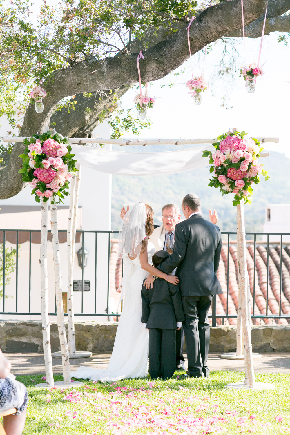 It was very important to this couple that the groom's son be an integral part of their day and I think this photo says it all.  I strongly believe that a beautiful ceremony is achieved by making sure what is important is front and center.  Photographer:  MiBelle   Florist:  Rock Rose   Venue:  Ojai Valley Inn & Spa
