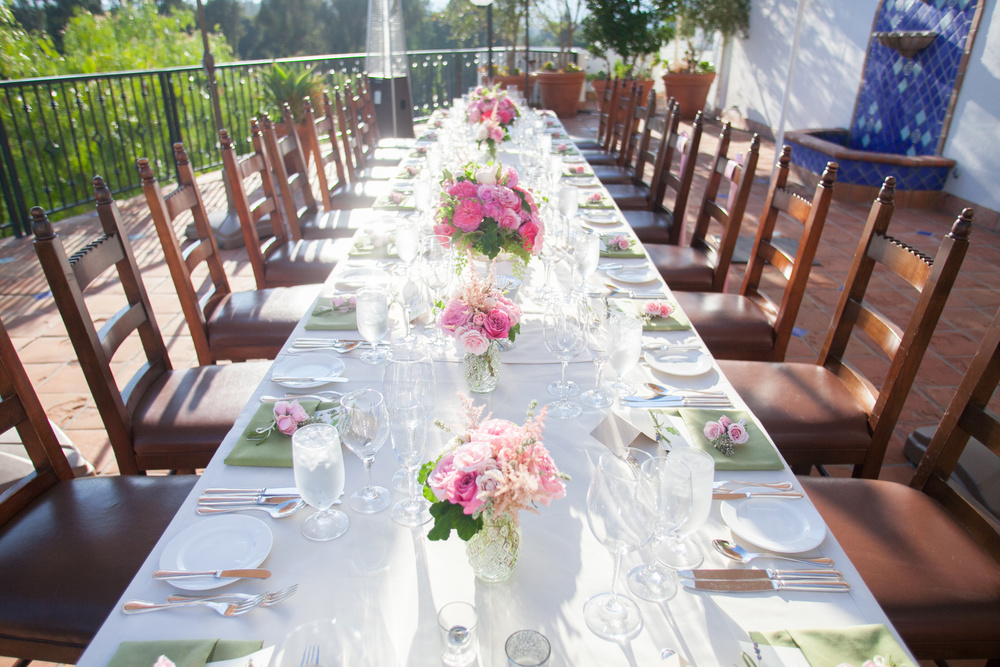 If you are going to keep it simple and use the ivory linen that most hotels provide make sure to bring the color down to the place setting.  With these beautiful florals we picked up the color of the greenery in the napkin and then placed a pink rose napkin treatment to pull it al together.  The effect is simply elegant..     Photographer:  MiBelle   Florist:  Rock Rose   Venue:  Ojai Valley Inn & Spa