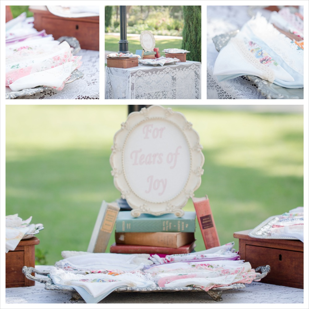 The bride loved all things vintage and she collected all these vintage handkerchiefs.  Add some vintage silver trays, vintage books and a beautiful vintage lace tablecloth and not only was it a beautiful decor statement but served a useful function and it was a takeaway for the guests!   Photo By: Fortuna Photography Venue: Camarillo Ranch House