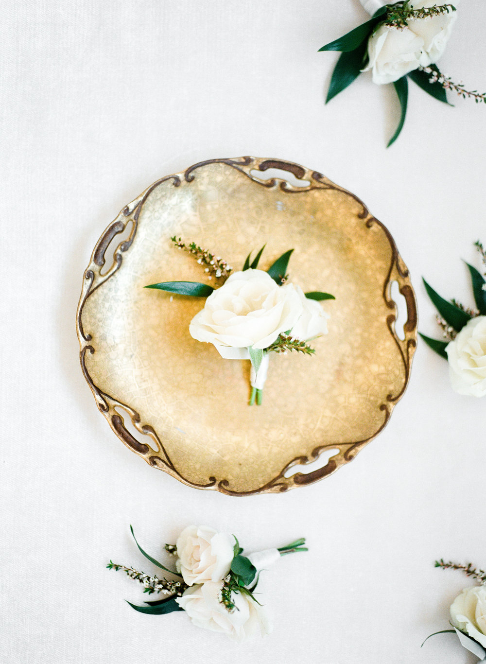 white rose and greenery boutonniere