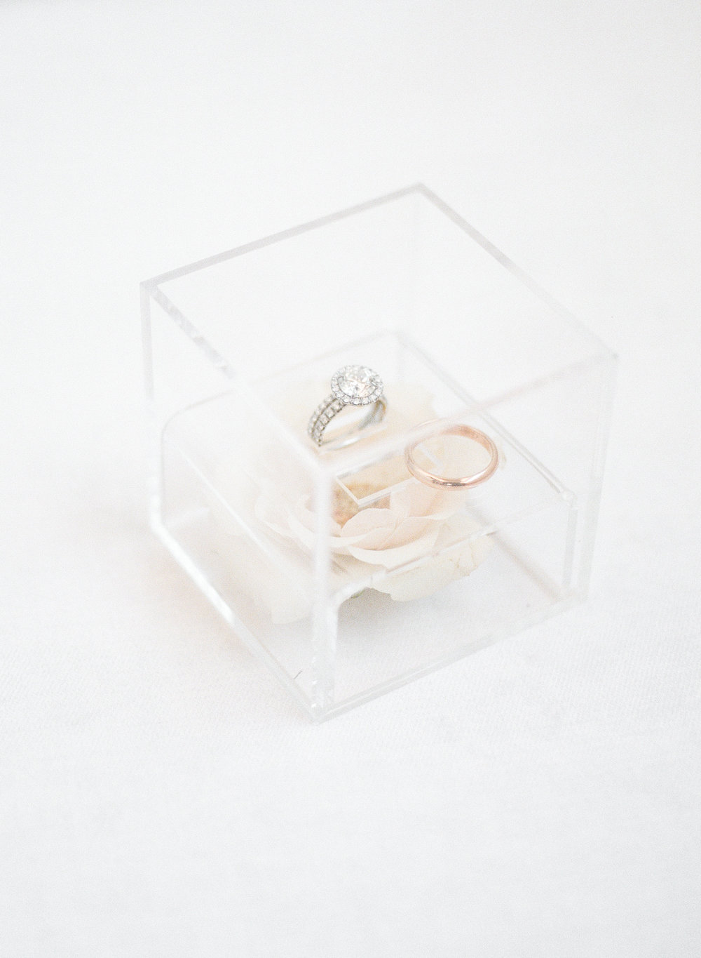 wedding rings in lucite box