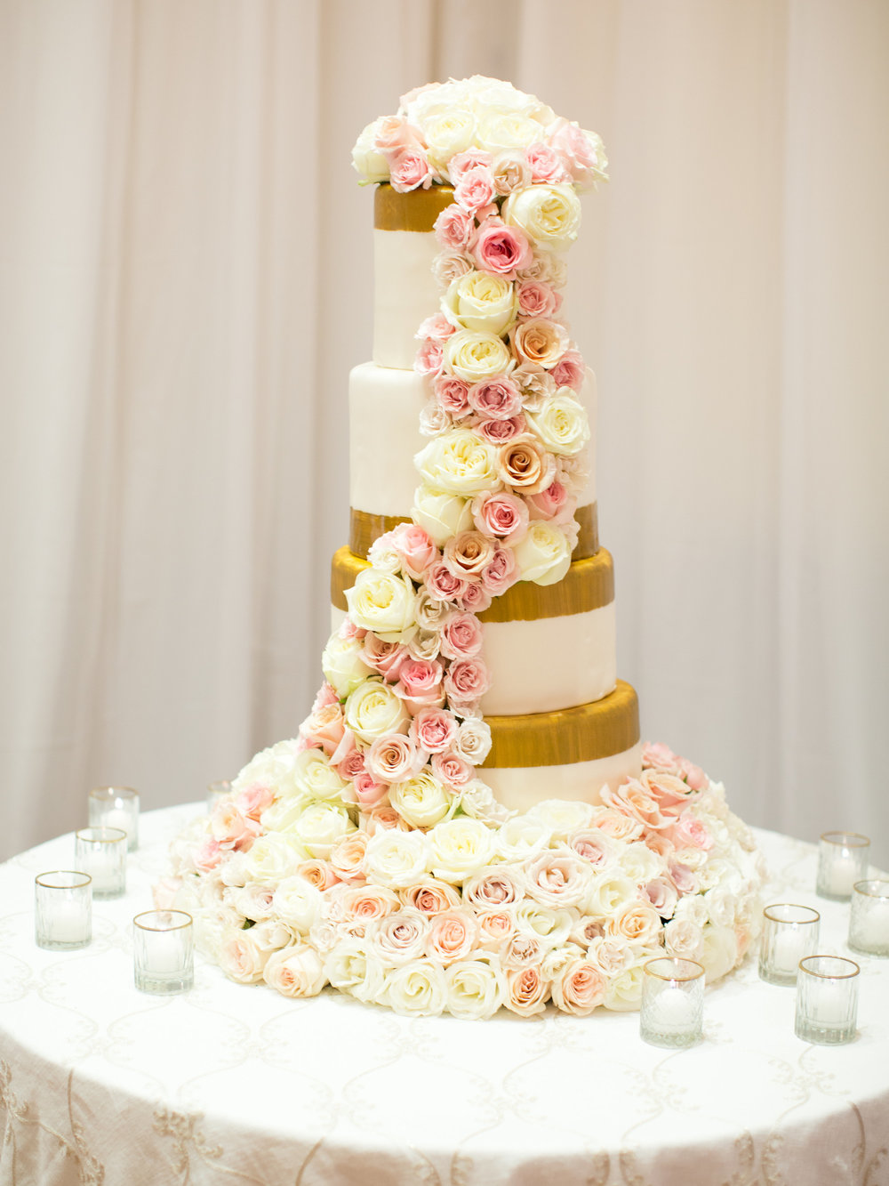 tiered blush and gold wedding cake