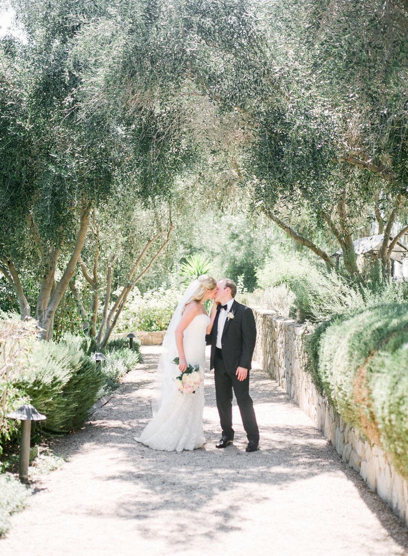 bride and groom kiss at Ojai Valley Inn