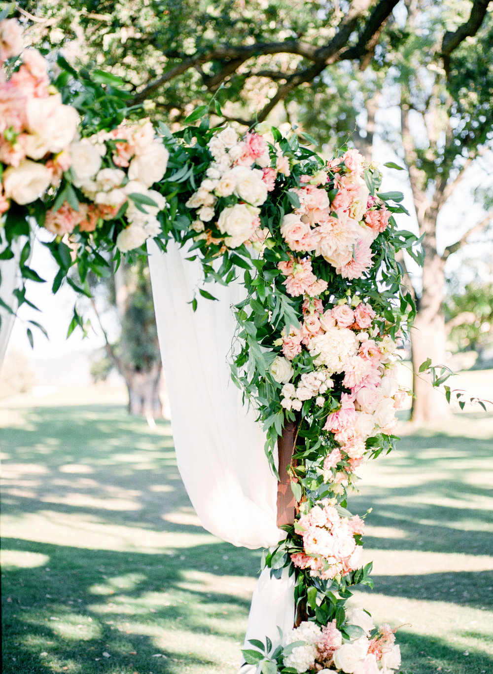 blush and ivory floral ceremony arch at Ojai Valley Inn