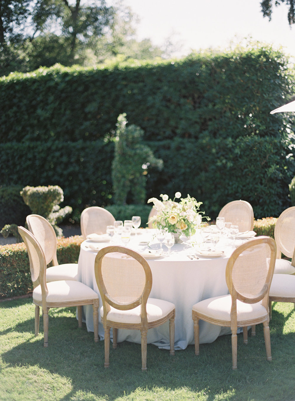 round table seating at garden reception