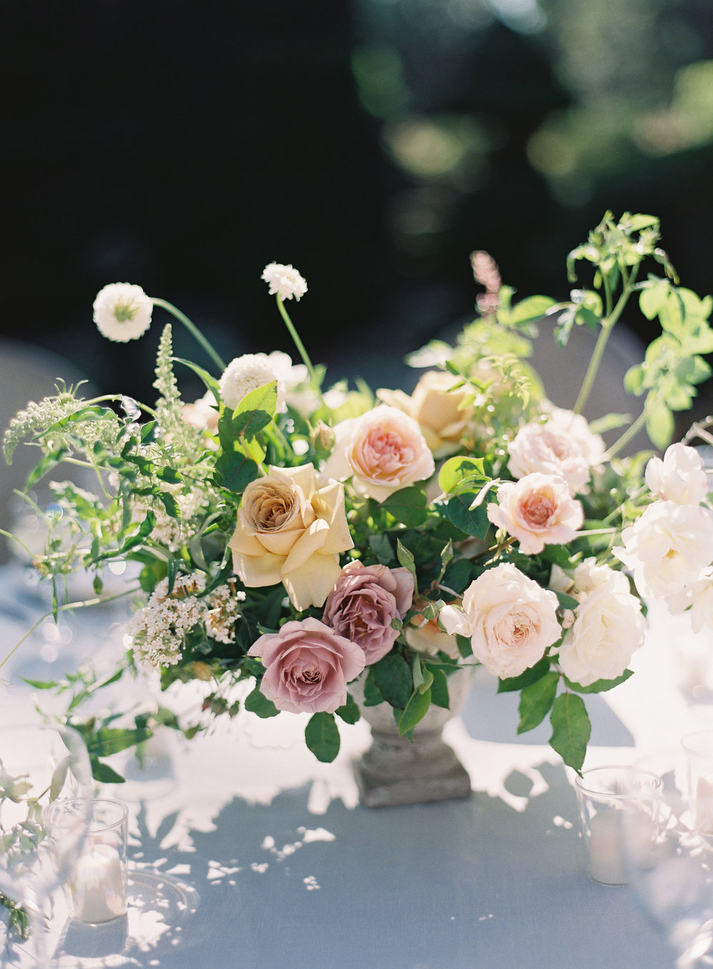 table centerpiece with garden roses and greenery
