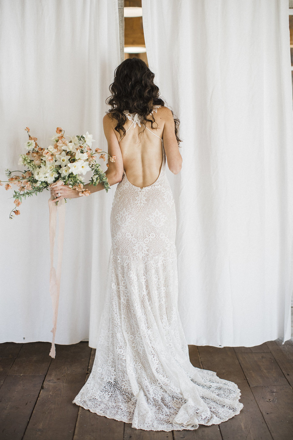 whimsical backless ivory wedding gown