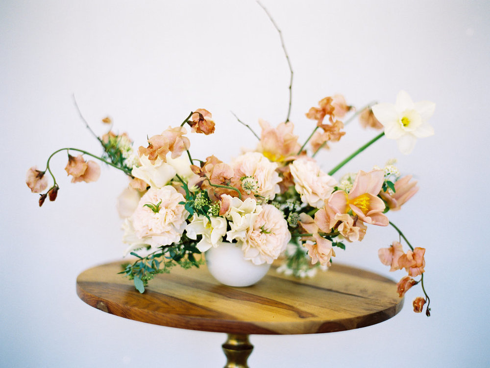 loose peach and ivory floral arrangement