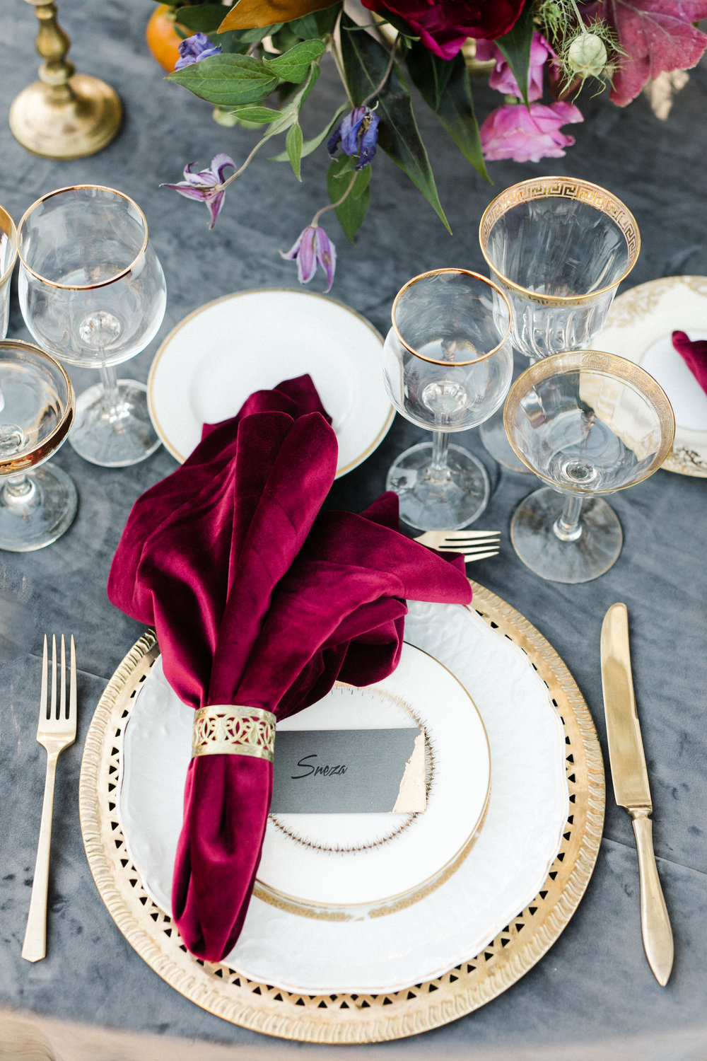 gold, grey, and burgundy place setting