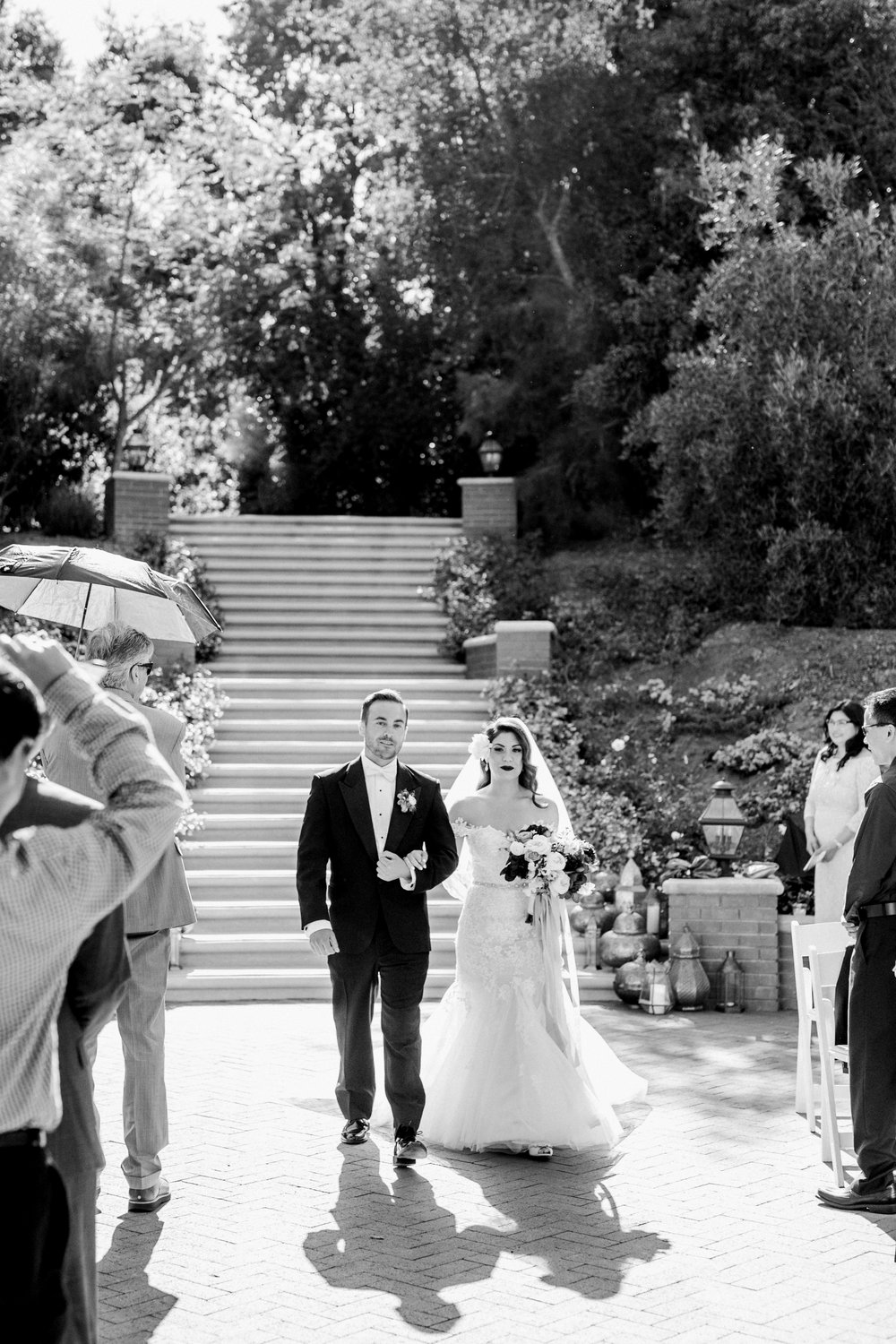 entrance of the bride in black and white