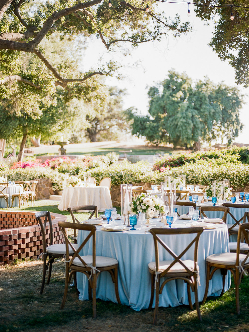 blue and white outdoor reception tables
