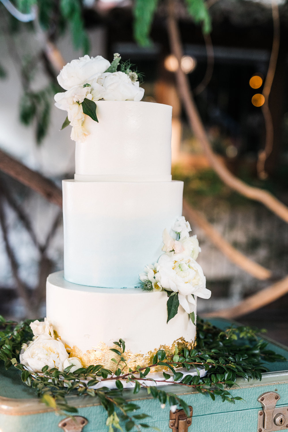 subtle ombre wedding cake with gold foil
