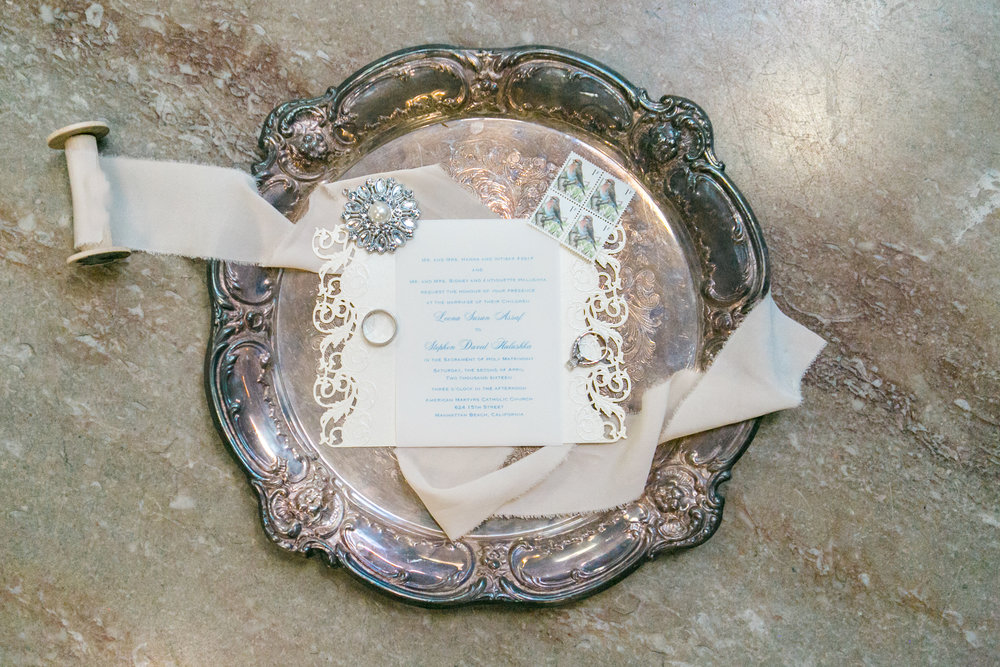 elegant wedding invitation on vintage tray