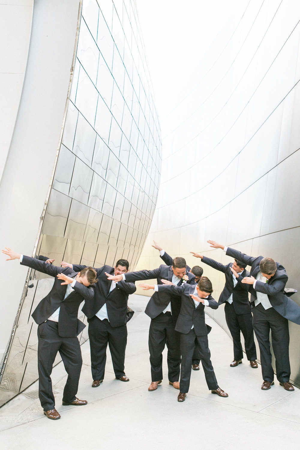 playful groomsmen pose