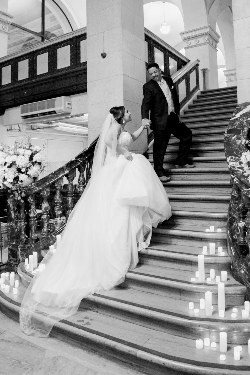 bride and groom portrait on candle lit staircase