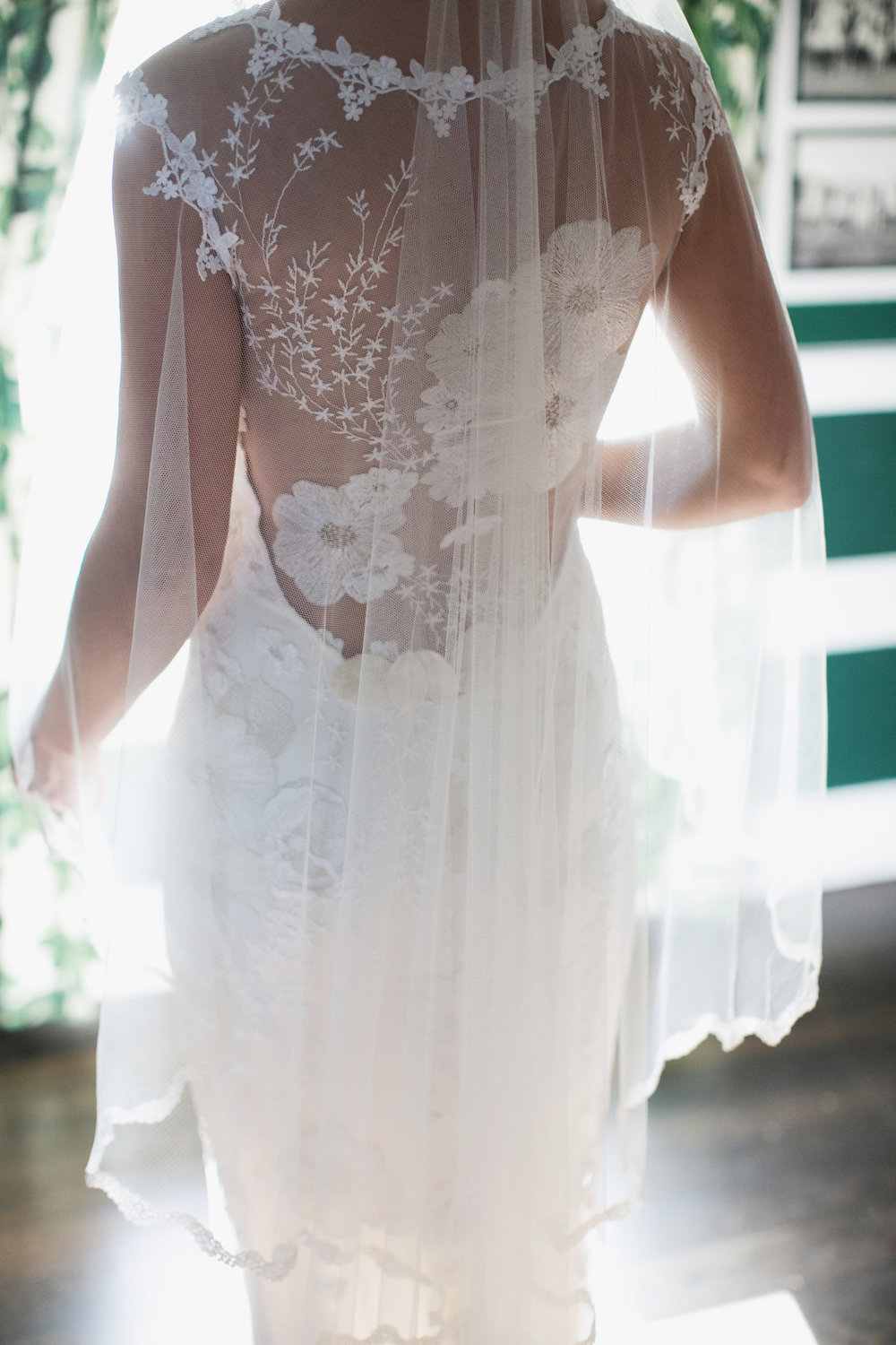 intricate lace back bridal gown detail