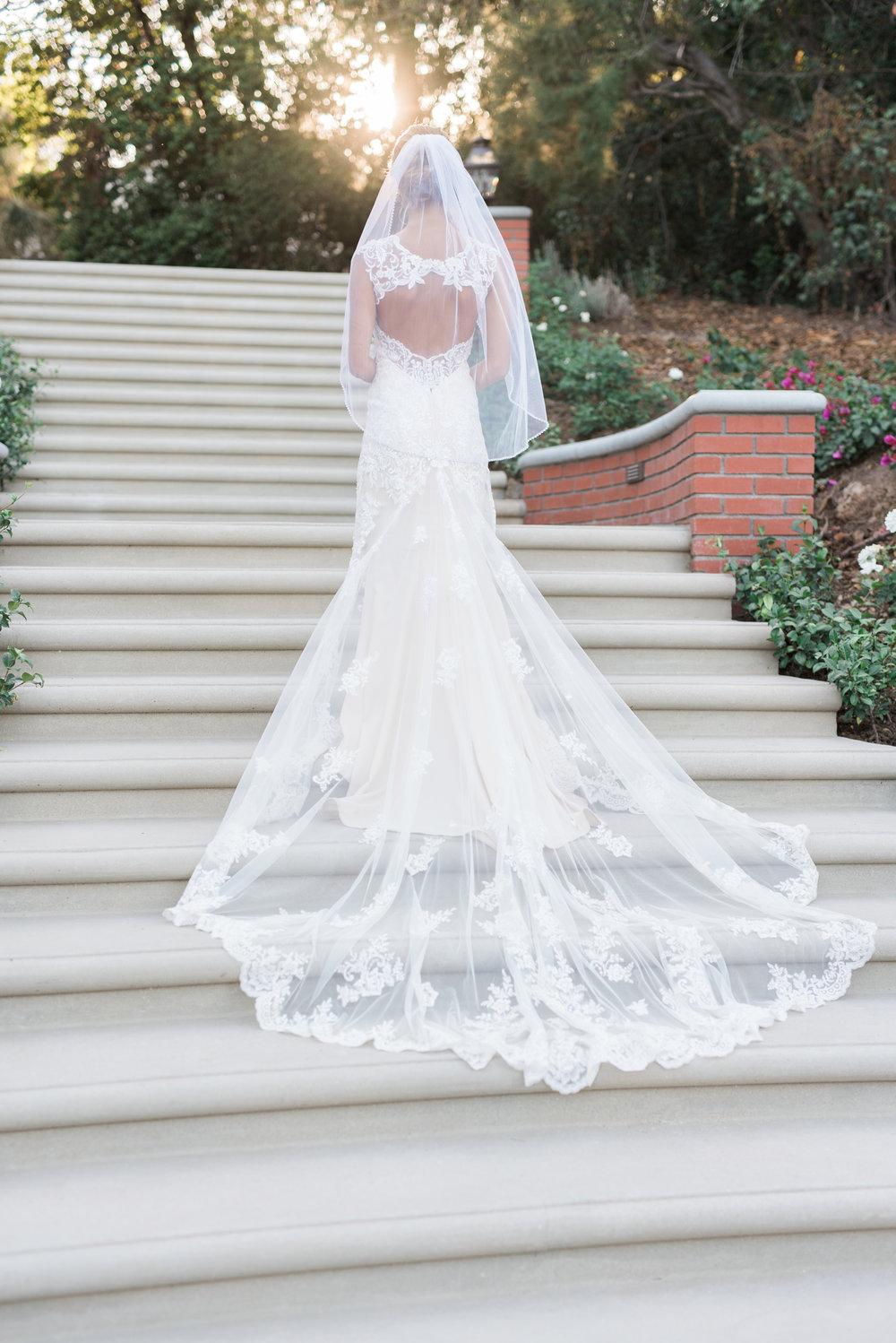 bride on staircase with long lace veil