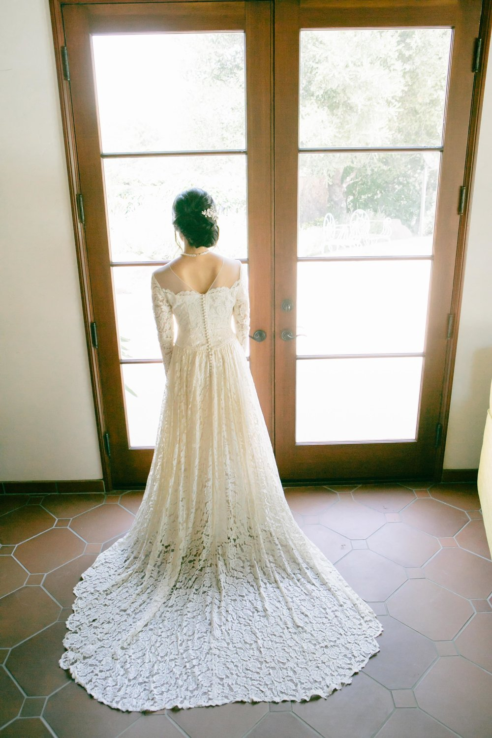 long sleeved lace train bridal gown
