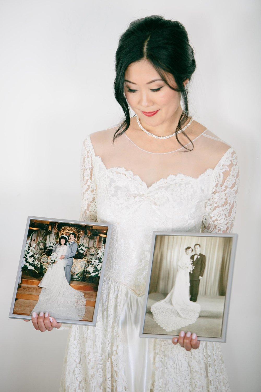 bride photo with parents' and grandparents' wedding portraits