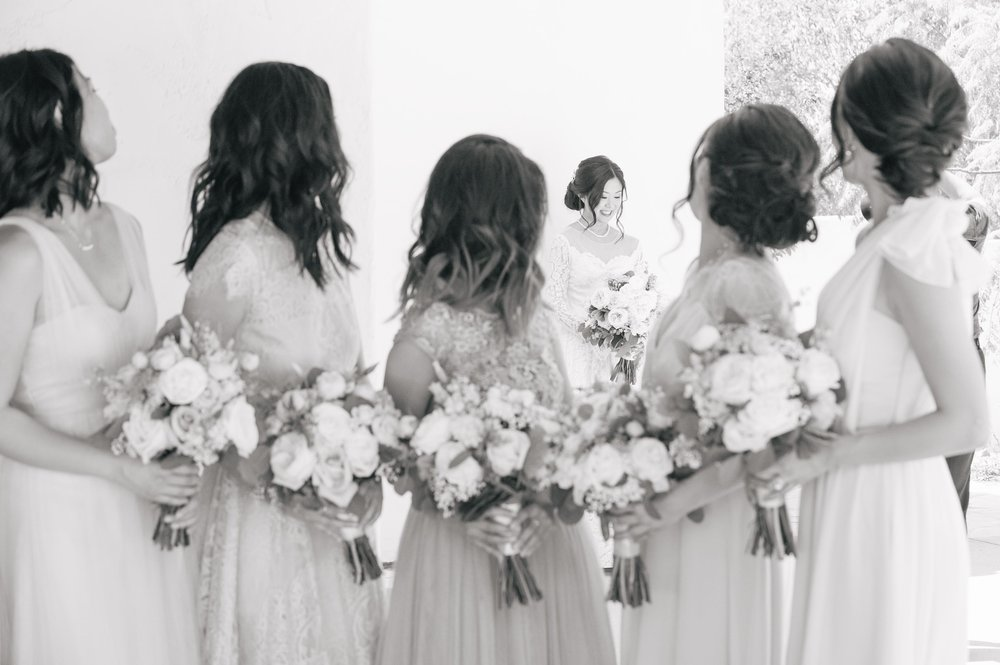 bridesmaids turning to see the bride