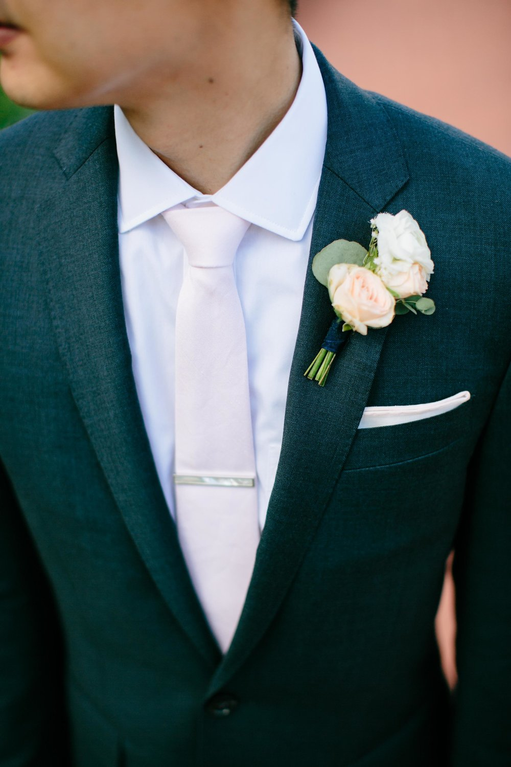 groom in dark gray and pink