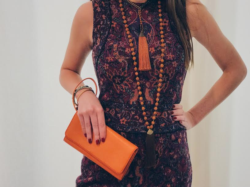 Our textile-inspired knit dress brings the style of Cuban architecture into a practical lifestyle. Want to accentuate tropical flare? Pair with our beaded tassel necklaces, inspired with native orange beads. A complimentary orange wallet further emphasizes the bright orange color so commonly associated with Cuban flare.